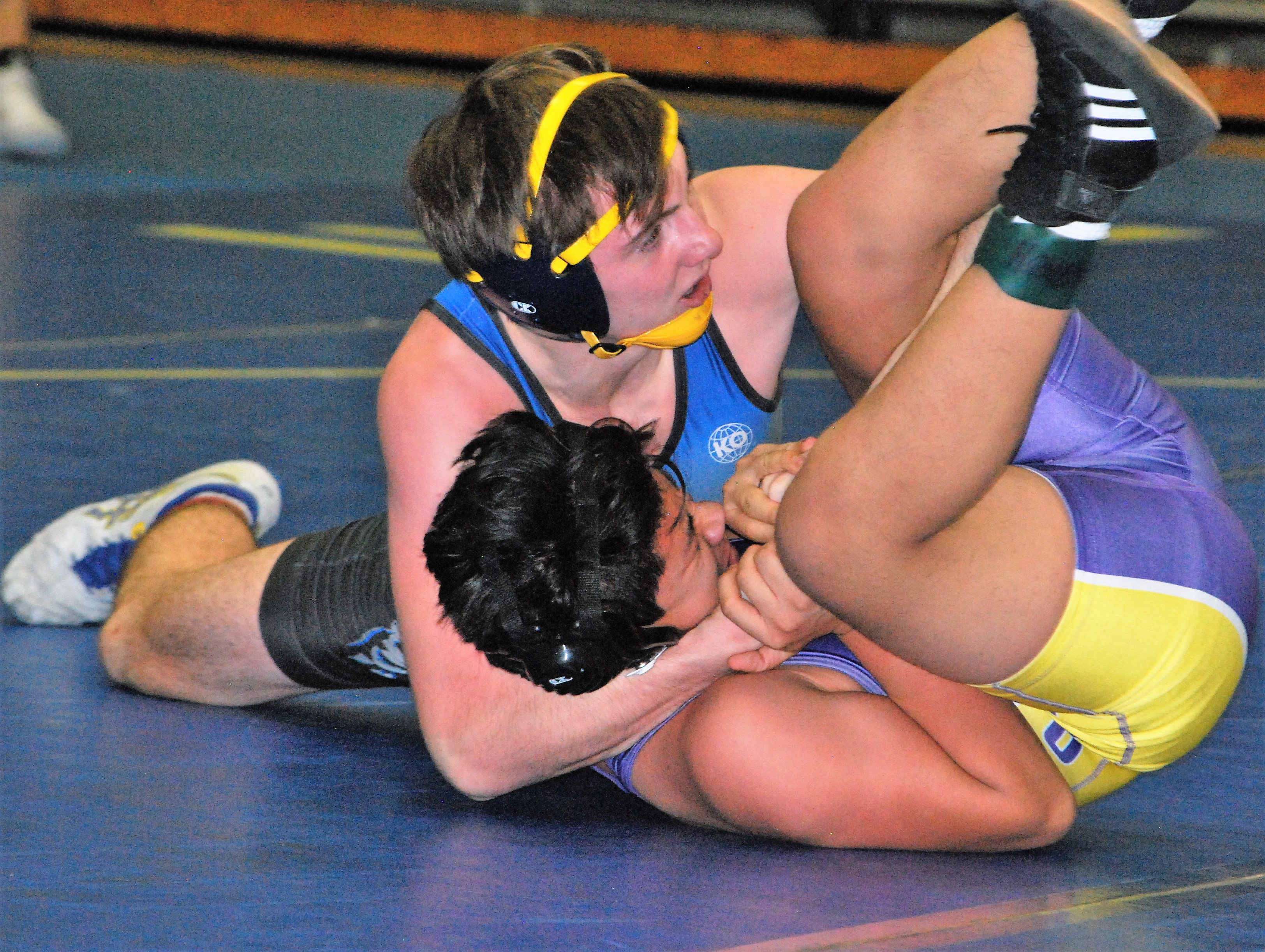 Fort Mill wrestler Brian Kelley tightens his grip on a Northwestern opponent in a recent win.