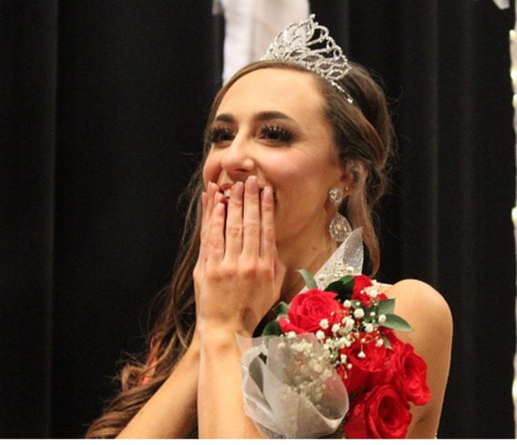 Payton Deal, wearing her tiara, covers her mouth with her hands and reacts with glee as her name is called to announce her as Miss Nation Ford.