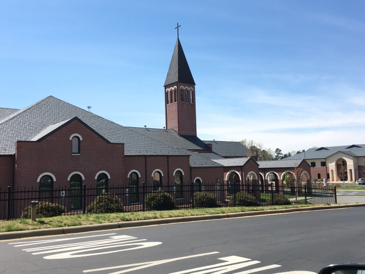 The exterior of St. Philip Neri Catholic Church in Fort Mill, including the parish hall and the steeple on top of the building.