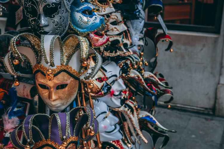 Mardi gras revelers in colorful masks and customes.