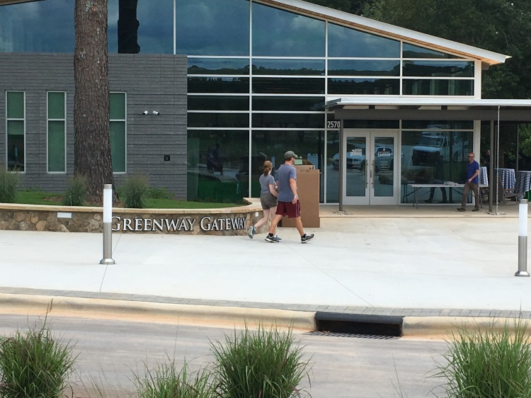 A young man and a young woman walk past the outside of the brand new Greenway Gateway building in Fort Mill, S.C.